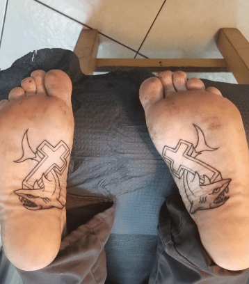 Crosses on the soles of your feet protects you from sharks